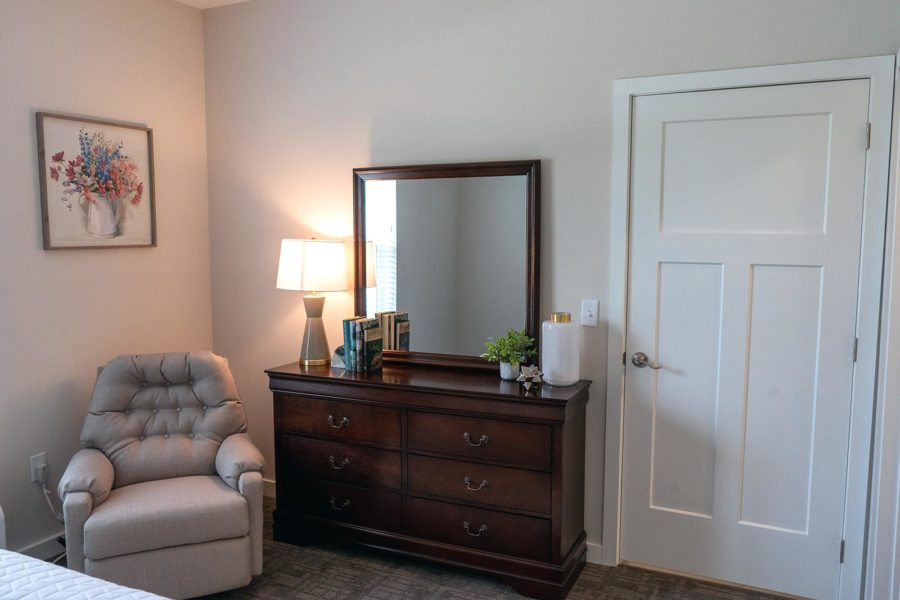View Of Bedroom Dresser With Mirror And Chair