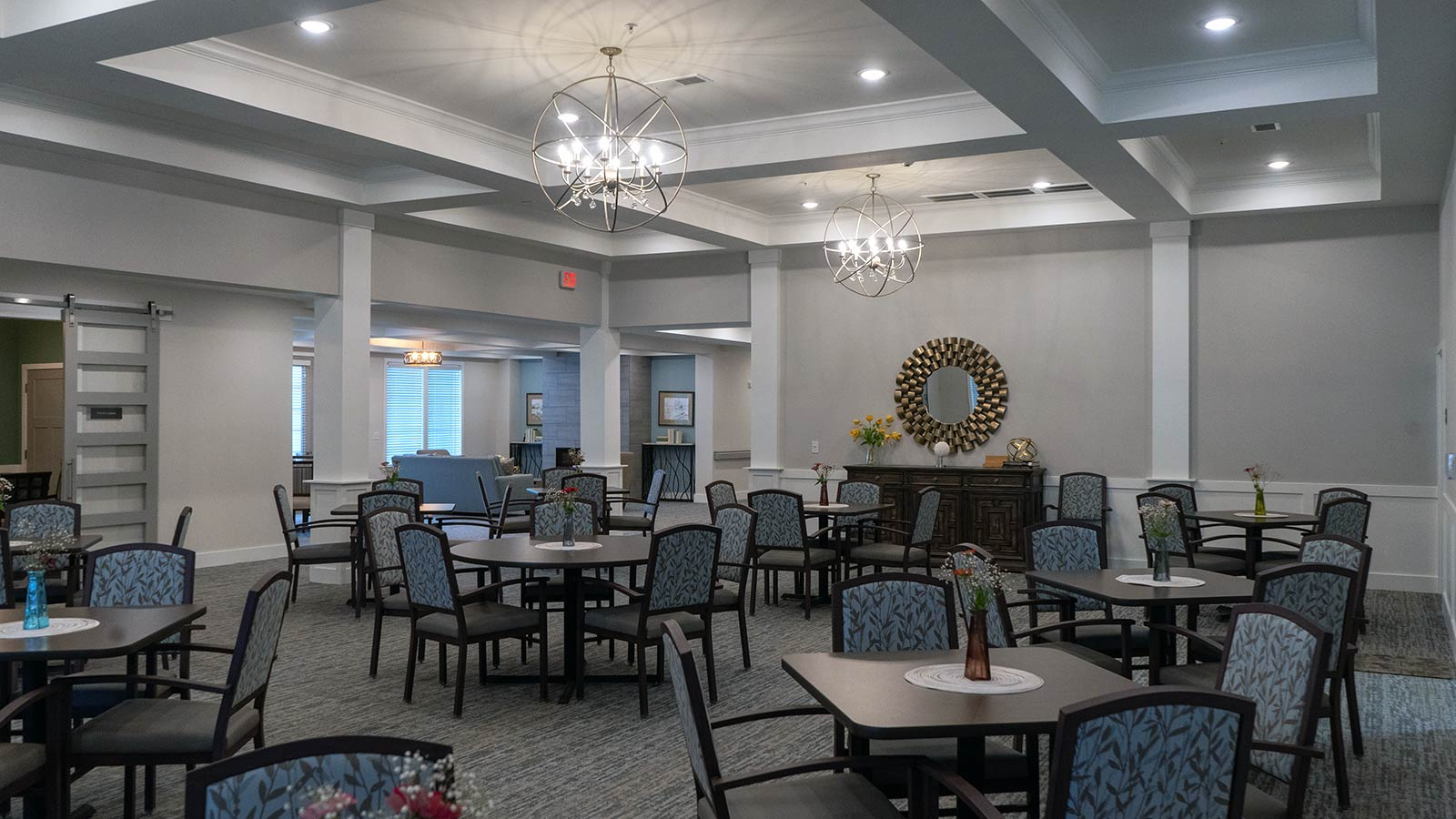 View Of Elegant Restaurant-style Dining Room With Tables And Chairs