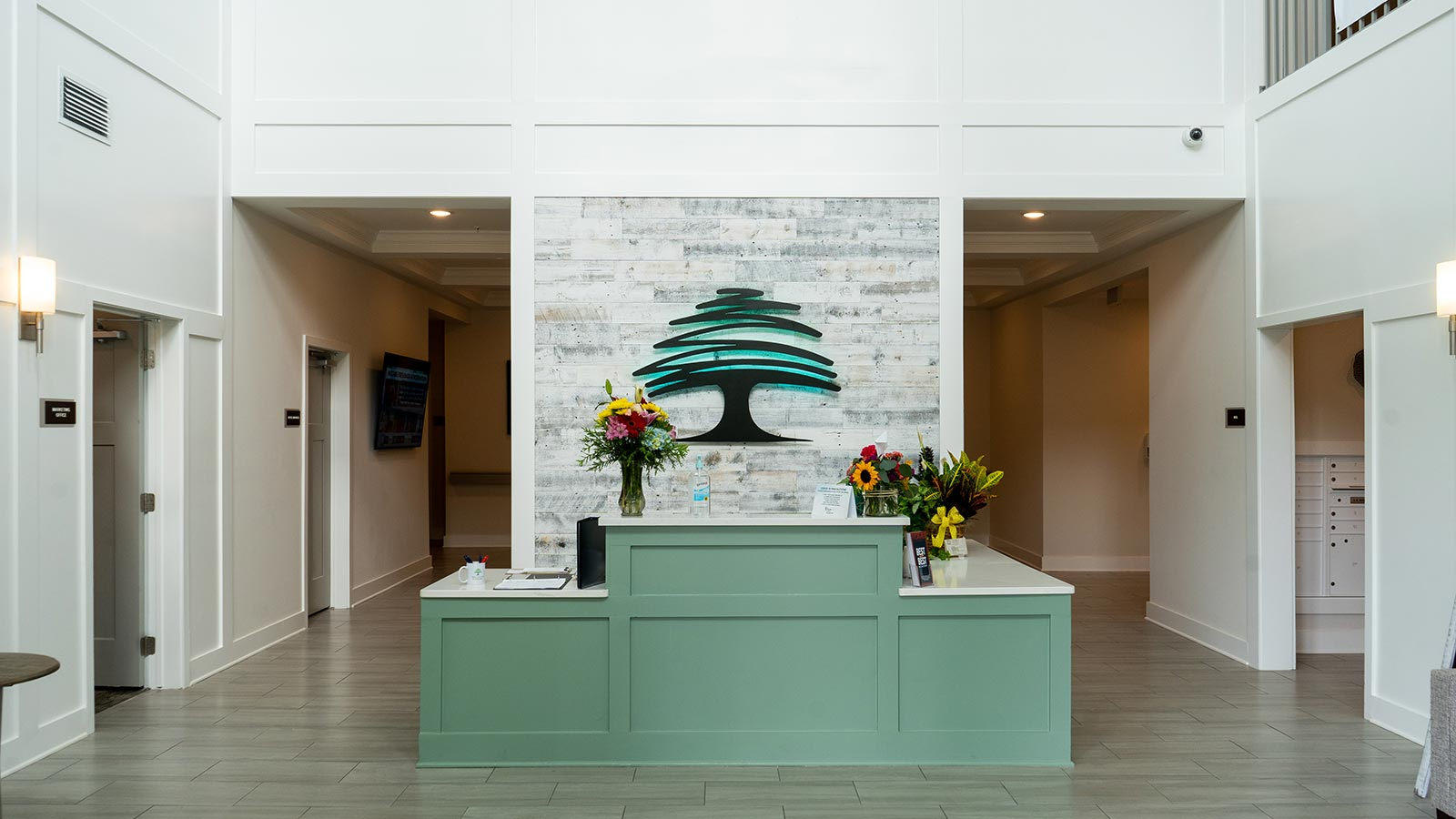 View of the main lobby front desk at The Canopy at Azalea Grove assisted living and memory care community in Valdosta, GA